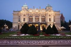 Juliusz Slowacki Theatre por noche en Kraków foto de archivo