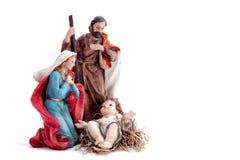 Juljulkrubba med den heliga familjen som isoleras på vit bakgrund royaltyfria bilder