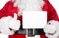 Juljultomten med ett kort Fotografering för Bildbyråer