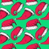 Juljultomtenhattar på turkosbakgrund stock illustrationer