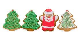 Julkakor med jultomten och träd som isoleras på Arkivfoto
