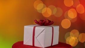 Julklapp som rotera och glider av oskarp blinkaxmas, tänder framme lager videofilmer