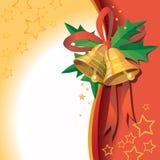 Julklockor med bandet på röd bakgrund royaltyfri bild