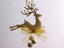 Julkort - guld- renprydnad Arkivfoton