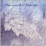 Julkort med Angel Wing och snöbakgrund royaltyfri fotografi