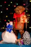 Julkort med apan och tomteblosset Royaltyfri Fotografi