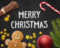 Julkort med en pepparkakaman och en julgarnering Royaltyfria Bilder