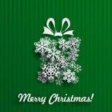 Julkort med gåvaasken av snöflingor Royaltyfri Foto
