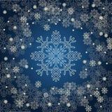 Julkort med guld- snöflingor på mörker - blå bakgrund Fotografering för Bildbyråer