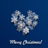 Julkort med hjärta av snöflingor Arkivbild