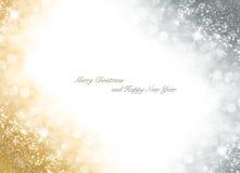Julkort med ljus sparkly bakgrund för guld och för silver Royaltyfri Bild