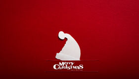 Julkort med origamijulgarneringen. Royaltyfri Fotografi