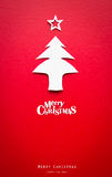 Julkort med origamijulgarneringen. Royaltyfria Bilder
