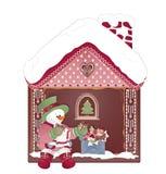 Julkort med snögubben och det ljust rödbrun huset royaltyfri bild