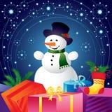 Julkort med snowmanen och gåvor Fotografering för Bildbyråer