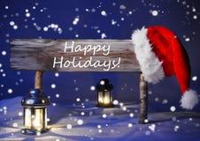 Julkort med tecknet, levande ljus Santa Hat, lyckliga ferier Arkivfoto