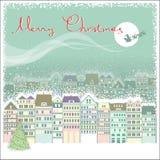 Julkortbakgrund med cityscape och jultomten Arkivbild