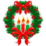 Julkrans med pilbågar och stearinljus Arkivbild
