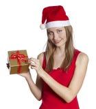 Julkvinna med gåvan Royaltyfri Foto
