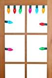 Jullampor i fönstret Arkivbild