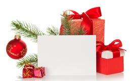 Julleksaker, gran-träd filial och tomt kort arkivfoto