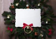 Julleksaker på filialer av en julgran med ramen Royaltyfria Foton