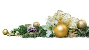 Julleksaker på granträdfilialen som isoleras på arkivbilder