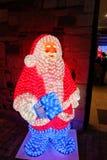 Julljus - jultomten Arkivbilder