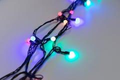 Julljus på draybakgrund arkivfoto