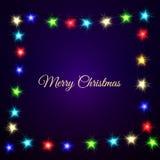 Julljus på mörk bakgrund Ram med text Arkivfoto