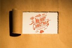 Julmeddelande på pappers- bakgrundsdesign Arkivfoto