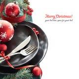 Julmenybegrepp med svarta plattor och bestick på Arkivfoton