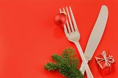 Julmenybegrepp över röd bakgrund Royaltyfri Fotografi