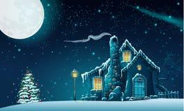 Julnatt med ett sagolikt hus och en julgran