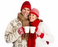 Julpar som dricker varmt te. royaltyfri fotografi