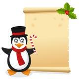 Julpergament med den roliga pingvinet Arkivfoto