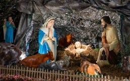Julplatsen med behandla som ett barn Jesus och hans familj Arkivbilder