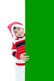 Julpojke med det tomma banret Arkivfoton
