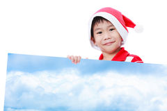 Julpojke med det tomma banret Royaltyfria Bilder