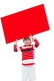Julpojke med det tomma banret Arkivbilder