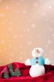 Julprydnad: snowmantoy och lilla trees Arkivbild