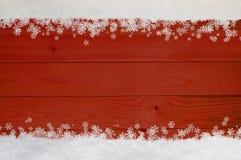 Julsnöflingagräns på rött trä Fotografering för Bildbyråer