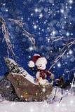 Julsnögubbe i släde 2 Royaltyfria Bilder