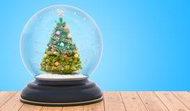 Julsnöjordklot med julgranen inom på trätaen fotografering för bildbyråer