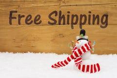 Julsnögubben med text frigör sändnings Royaltyfri Fotografi