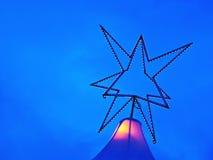 Julstjärna - ljus lek Arkivbild