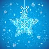 Julstjärna med snowflakesblått. Arkivbild