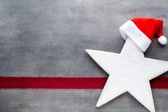 Julstjärnasanta hatt Den Seamless modellen kan användas för wallpaperen, modellpåfyllningar, rengöringsduksidabakgrund, surface t Arkivfoton