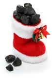 Julstrumpa mycket av kol royaltyfria foton
