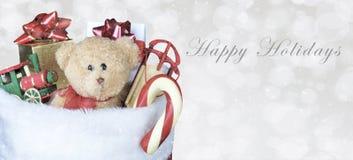 Julstrumpa som fylls med leksaker - banerformat vektor illustrationer
